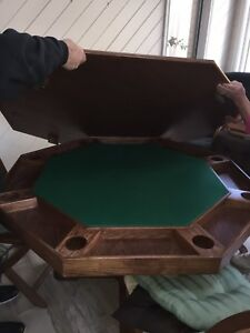 Solid oak games table with four chairs