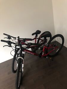 Brand New Mountain Bikes for Sale (Includes 2 helmets)