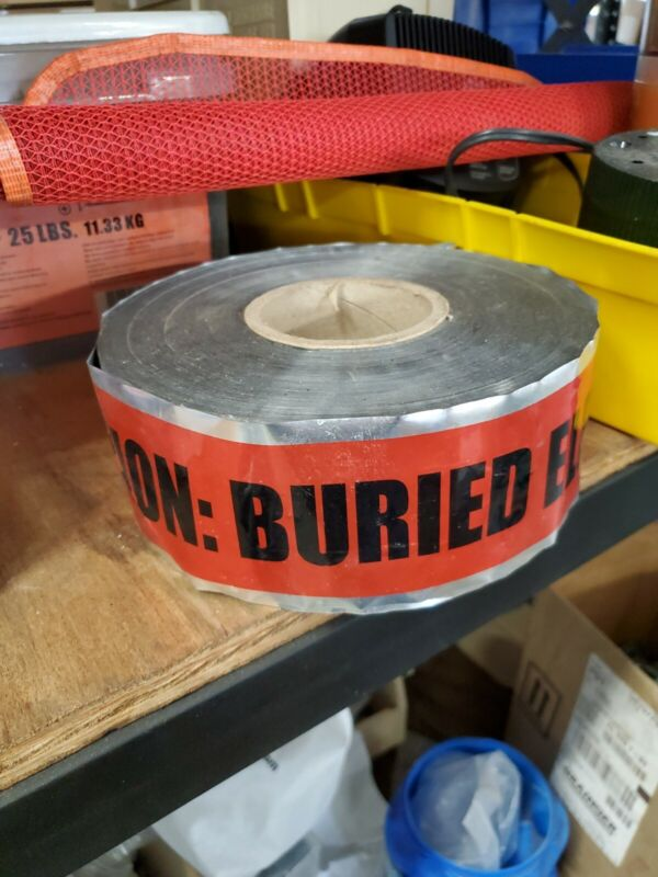 caution tape burried electric roll