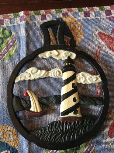 RARE VINTAGE CAST IRON TRIVET COLORED CAST IRON LIGHTHOUSE TRIVET