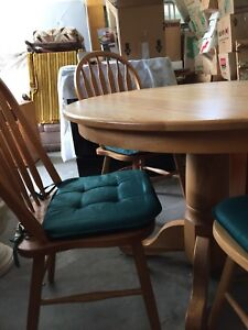 """42"""" solid oak kitchen table with chairs and removable leaf."""