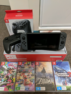Nintendo switch console pro controller and 4 games