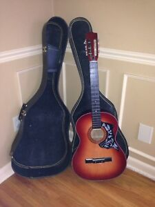 Vintage guitar for playing love songs, with hard shell case!