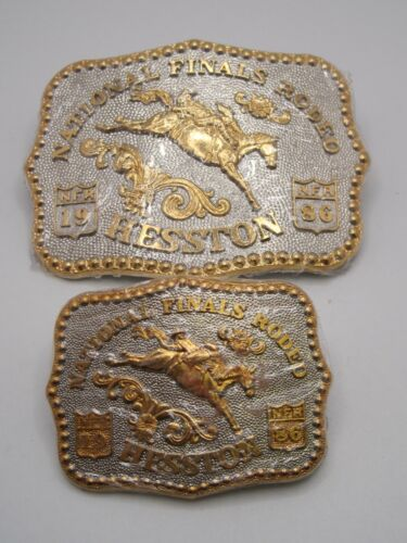 HESSTON GOLD & SILVER PLATED 1986 MATCHING NUMBER SET ADULT & YOUTH NEW BUCKLES