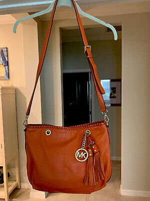 MICHAEL KORS ORANGE LEATHER HOBO HANDBAG WITH DOUBLE TASSEL!