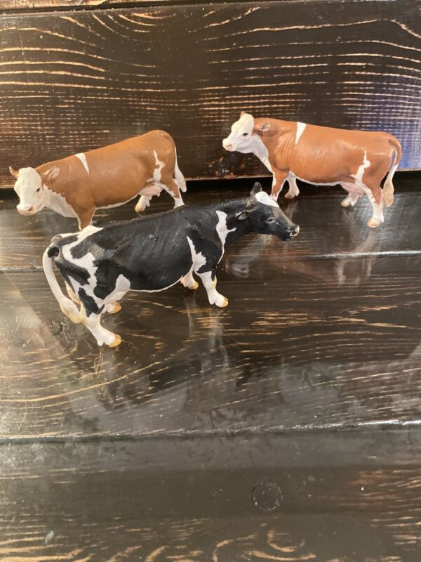 Schleich Black & White Holstein Dairy Cow and brown lot of 3