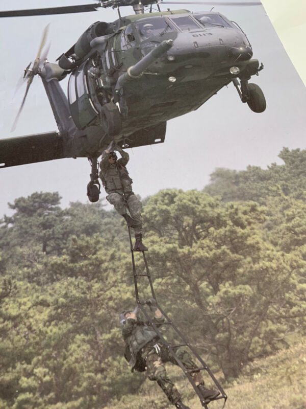 Glossy Color United Technologies Sikorsky Aircraft Poster Troops Action Picture