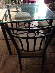 Glass dining table and 4 chairs black wrought iron Regents Park Logan Area Preview