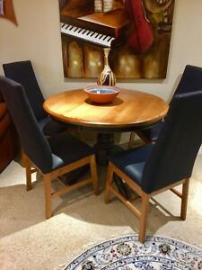 Round  wooden dining table with four chairs