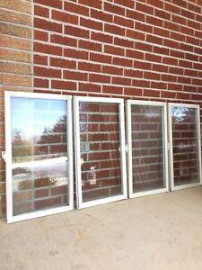 "Four Vinyl windows (19""x35)"