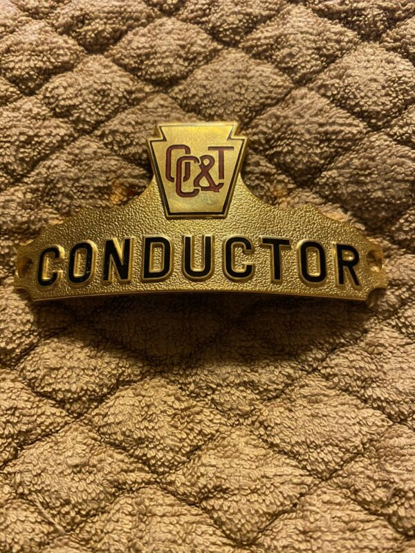 OIL CREEK & TITUSVILLE CONDUCTOR HAT BADGE