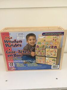 4 wooden puzzles with holder