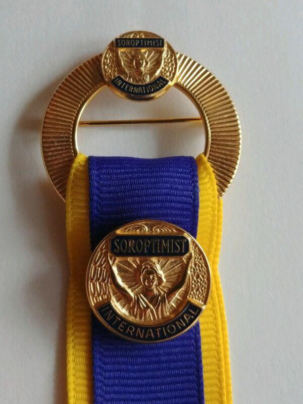 Soroptimist International Golden Metal Ribbon Pin