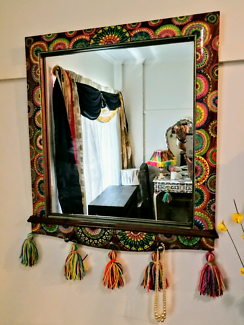 Mirror. Artist restored. Three pegs  for hanging