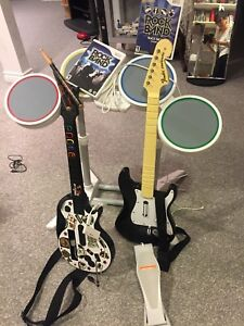 Wii set with drums ,guitar and the games