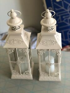 Rose lanterns with used candles