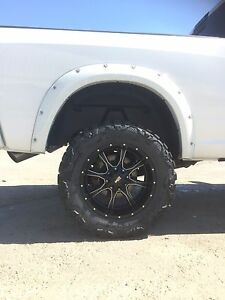 Nitto Mud Grappler Xtreme tires on 20x10 Moto Metal Rims