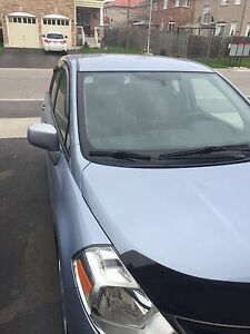 Nissan Versa Hatchback 1.8SL still under warranty $7500