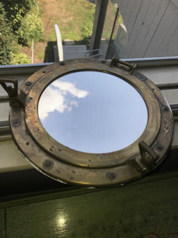 11 1/2 Inch vintage porthole  Brass Mirror in working condition