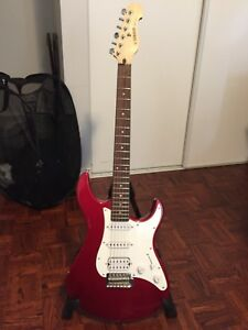 Red Yamaha electric guitar