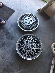 2 pair of 14 inch hubcaps