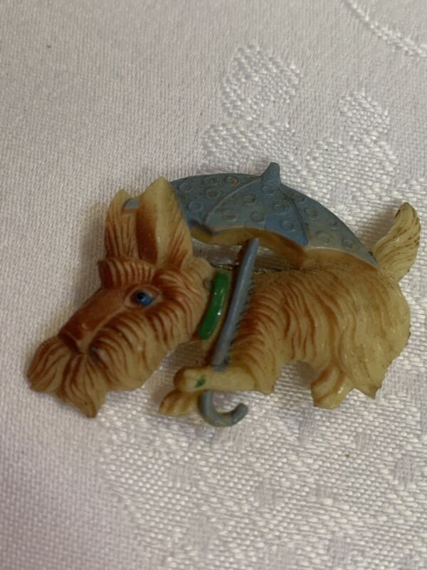 P37-VINTAGE SCOTTY SCOTTIE DOG CELLULOID BROOCH/PIN w/UMBRELLA  Unique