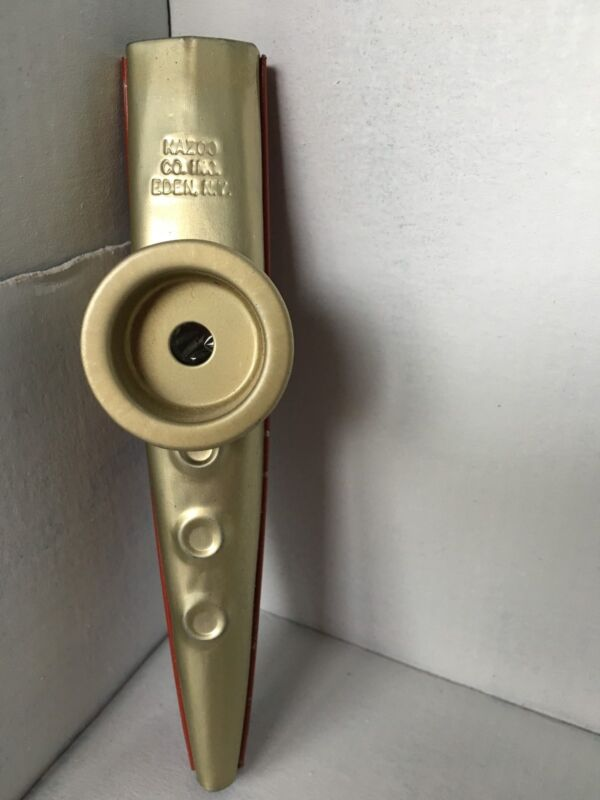kazoo Co. used made in Eden, NY goldtone with red bottom some scratches