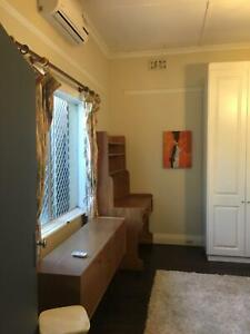 LARGE AIRCONDITIONED/FURNISHED ROOM FOR COUPLE/SINGLE CLOSE TO CITY