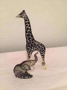 Giraffe and elephant figurines