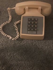Vintage beige touch tone/push button corded phone