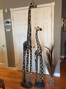 """Giraffe (80"""" high) and baby (44"""")with foliage.  $75.00 Firm."""