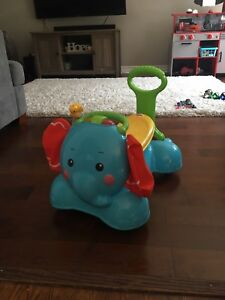 Elephant walker/ ride on fisher price