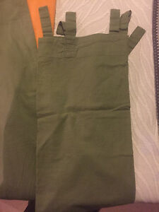 2 panel curtains army green in good condition.