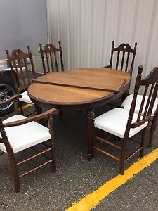 Dark brown solid wood table with 6 chairs
