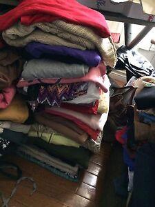 Garbage bag full of Ladies size Large clothing