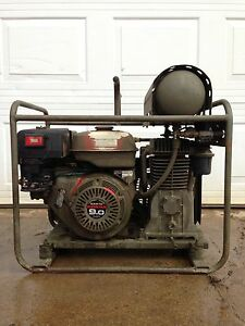 9hp honda, two stage air compresor, like new only ran 3 hours