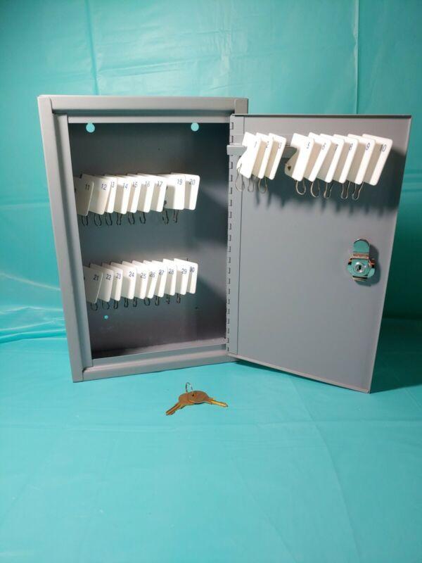 locking metal cabinet holds 30 keys
