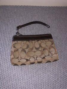Women's brown/beige monogrammed coach pouch