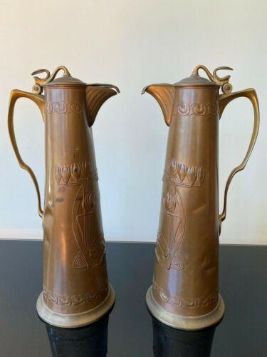 Fabulous pair of tall Art Nouveau Copper Claret Jugs by Carl Deffner.