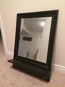 Mirror with shelf and hooks