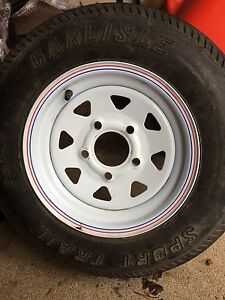 """2 new 12"""" rims with old tires"""