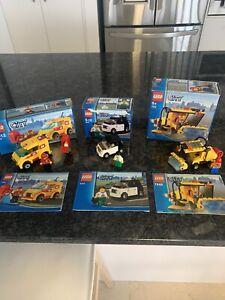 Three LEGO city vehicles