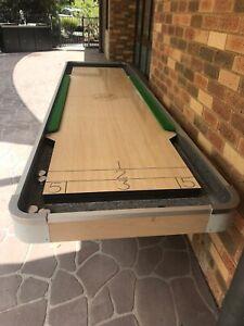 12' shuffleboard table with pucks