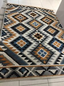 FLOOR RUG ( AS NEW ) TRIBAL DESIGN