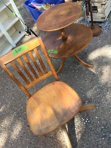 Antique side table and swivel chair.