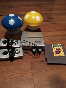 Retro Nintendo with 2 controllers and Super Mario 3