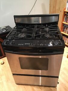 KitchenAid stainless steel gas stove with convection.