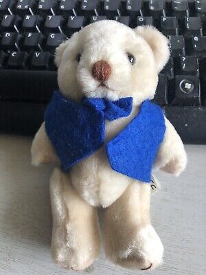 New Small Bear With Moveable arms and legs wearing a Blue Waistcoat and Bow tie