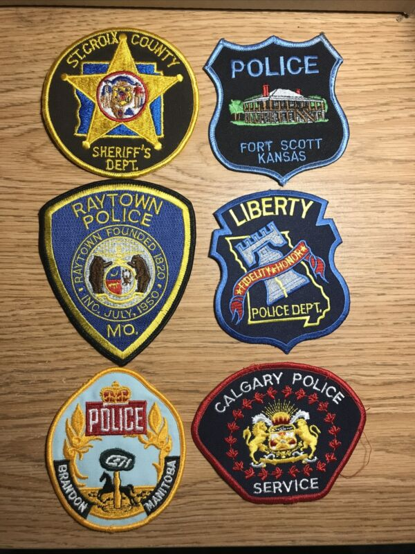 police patches:St Croix Co. WI,Ft Scott,Raytown,Liberty, Brandon&Calgary Canada