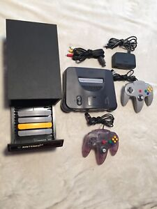 Nintendo 64 console + 2 controllers + N64 Rare game case + games